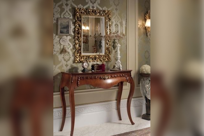Console table, dark wood color, decoration with gold leaf