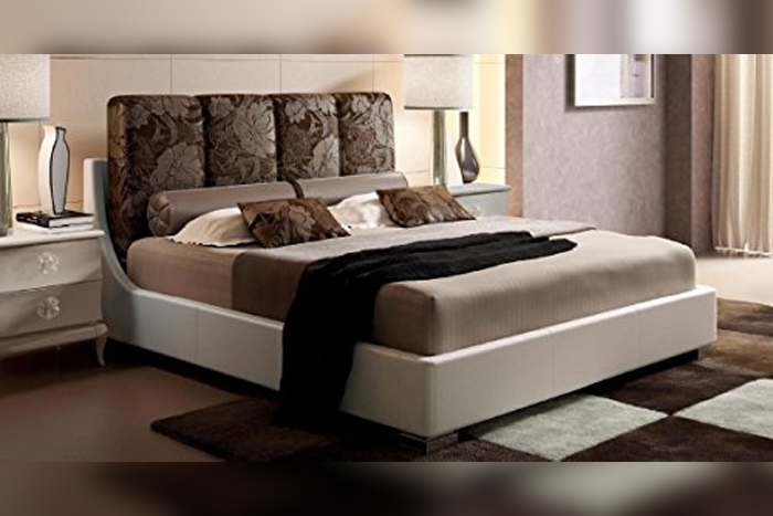 Double bed with pillows, pattern material, brown color