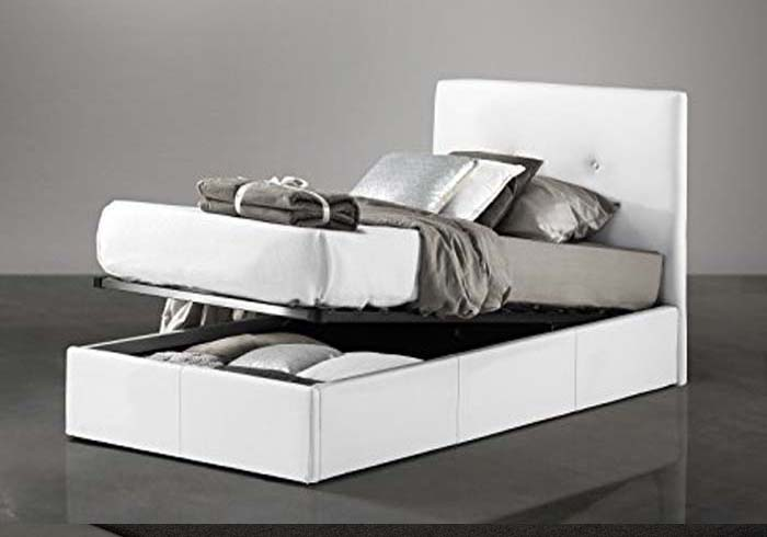 Single bed and a half with storage compartment and pillows on the headboard
